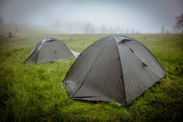 Camping tent within a heavy rain shower and mist